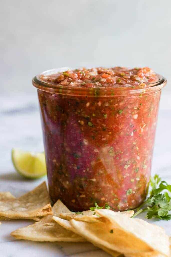 Jar full of homemade salsa and tortilla chips