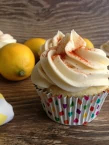 Lemon Cupcakes filled with a sweet, tangy lemon filling and frosted with Maple Syrup cream cheese frosting