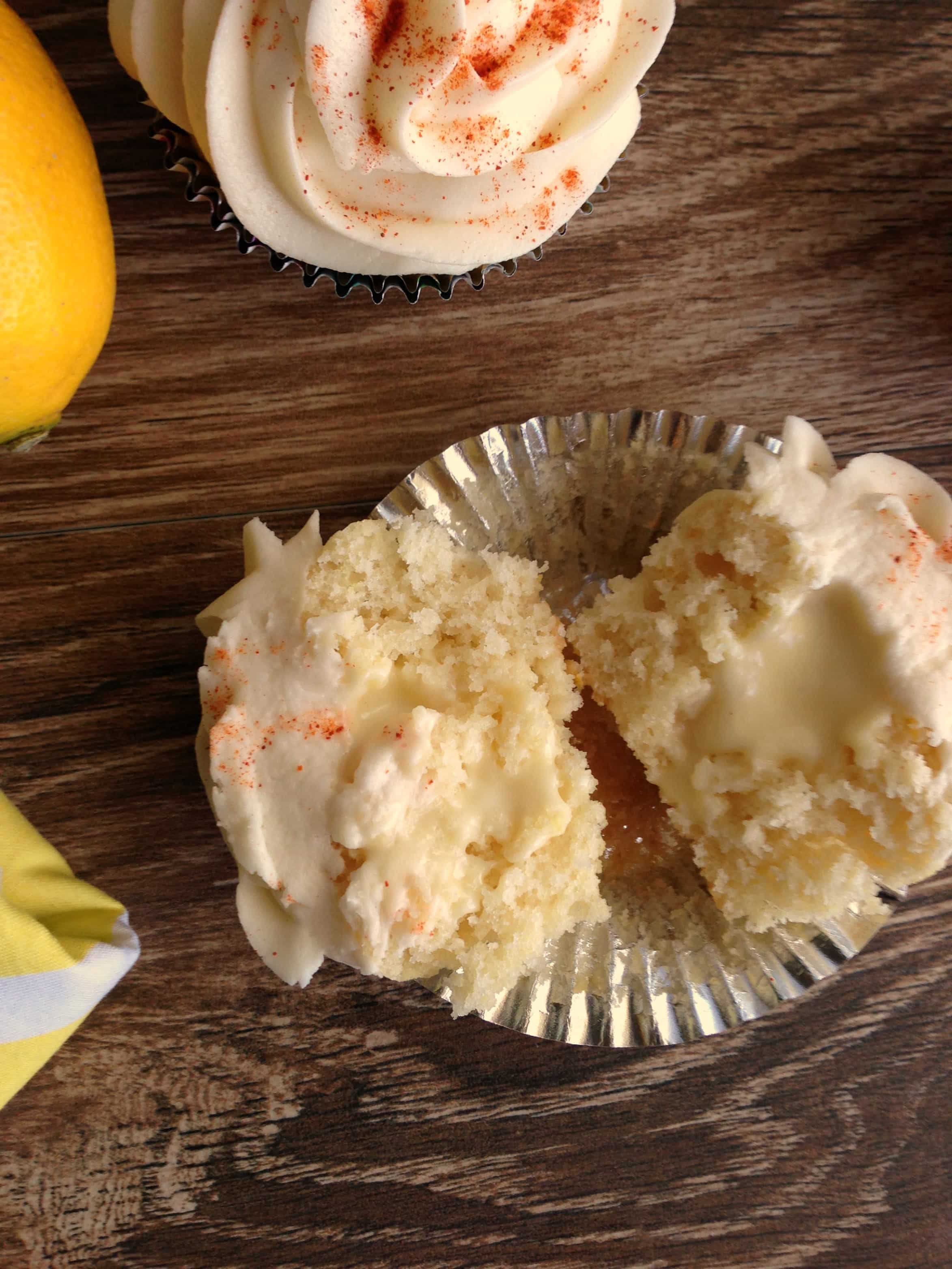 Split cupcake showing the filling in the center.