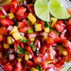 Close up of the strawberry mango salsa, showing the bits of onion and cilantro.