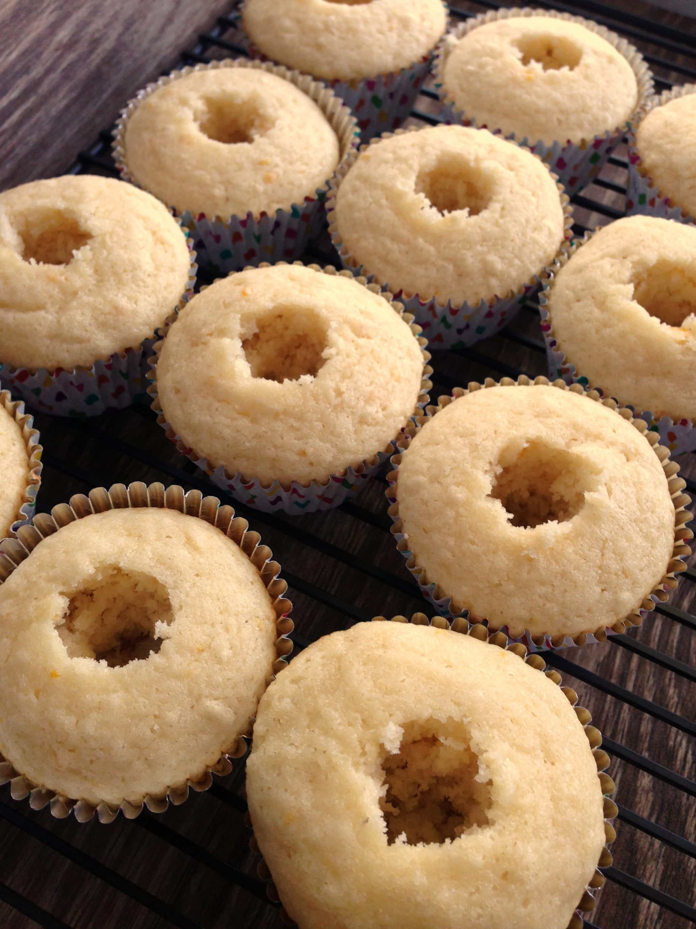 Lemon cupcakes with the centers removed for filling.