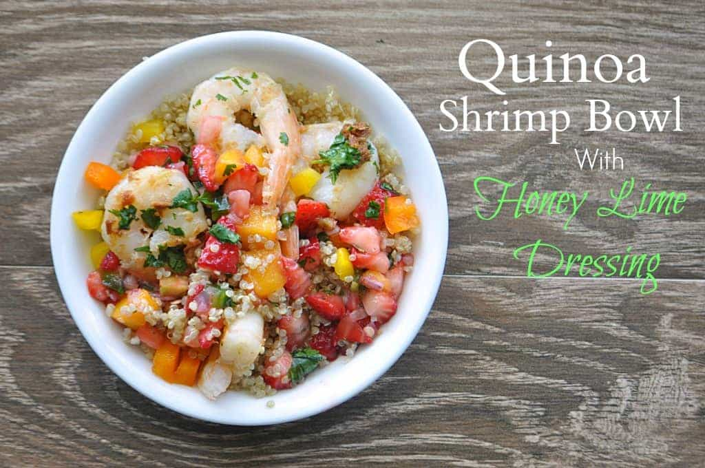 Quinoa shrimp bowl with a honey lime dressing and topped with strawberry mango salsa! So easy to make and full of flavor! Gluten free. Pin now to make later!! Recipe @ www.houseofyumm.com
