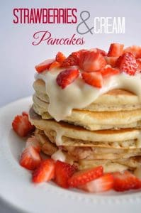 Strawberry Pancakes topped with a luxurious cream cheese glaze and fresh cut strawberries.  www.houseofyumm.com