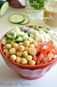 This quinoa salad is loaded with healthy veggies, feta cheese, and topped with a delectable dijon vinaigrette