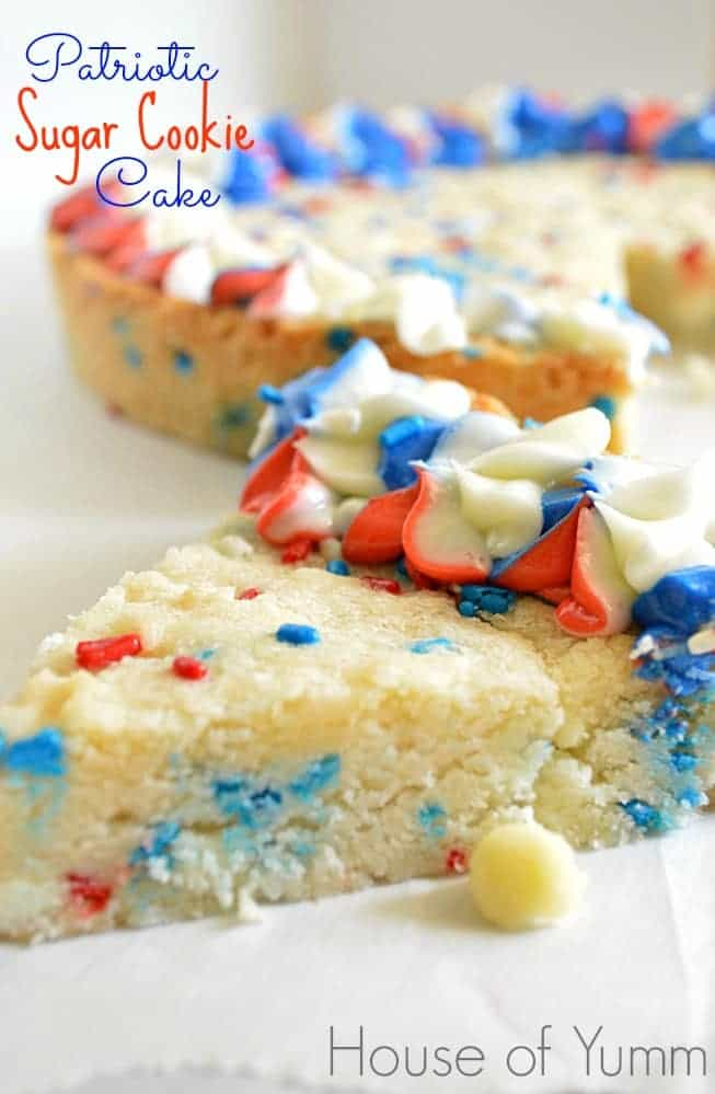 Celebrate the Fourth of July with this Patriotic Sugar Cookie Cake.  This sugar cookie cake is loaded with white chocolate chips and red white and blue sprinkles!  Topped with a tri-color swirled buttercream frosting!