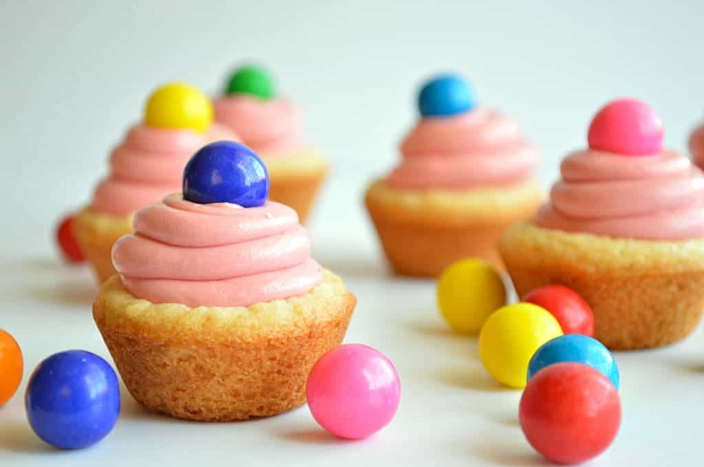 Sugar cookie cups filled with bubble gum flavored frosting and topped with a gumball!