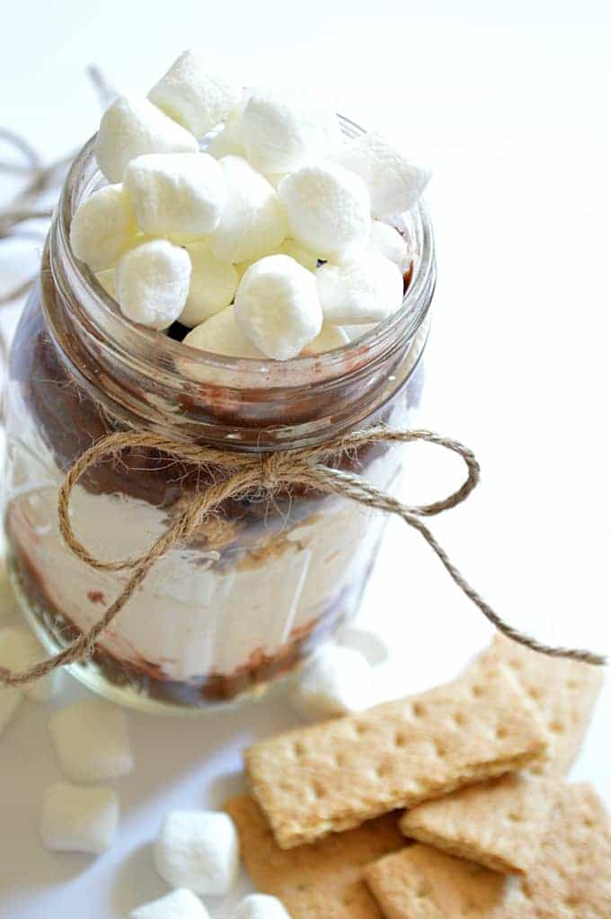 This s'mores pudding is layered with chocolate pudding, marshmallow creme, and graham crackers.  Topped with even more marshmallows!  Such a fun and easy way to get your s'more on!