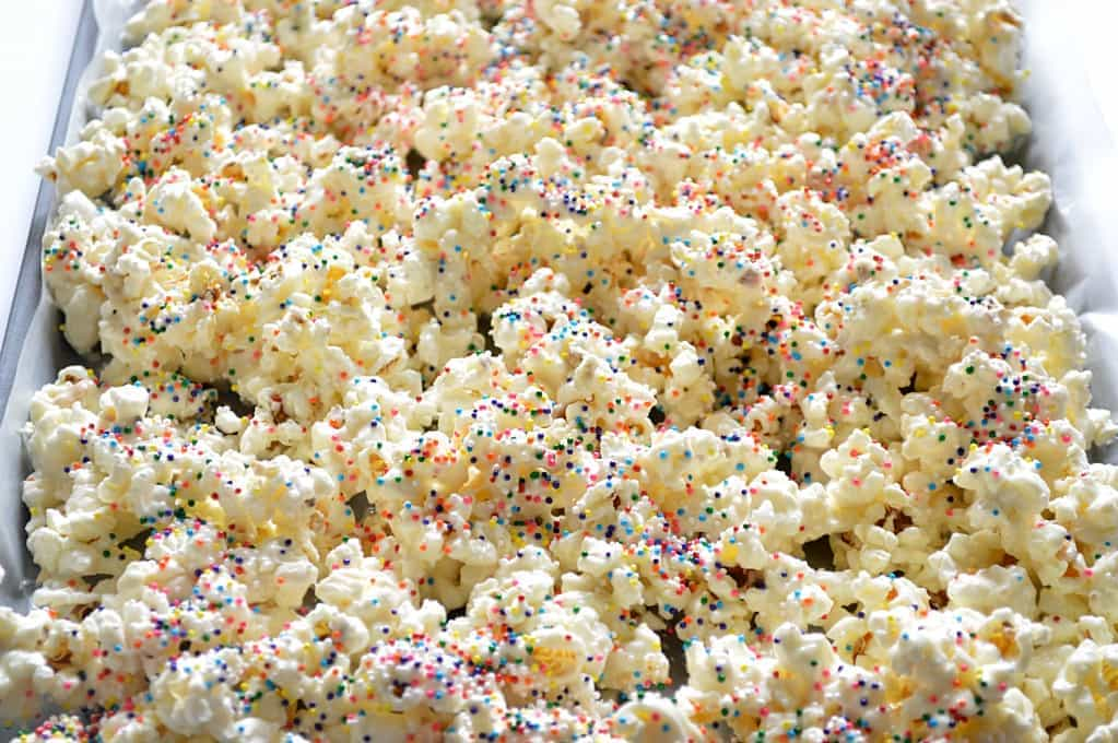 Circus Animal Cookie Popcorn drying on a cookie sheet.