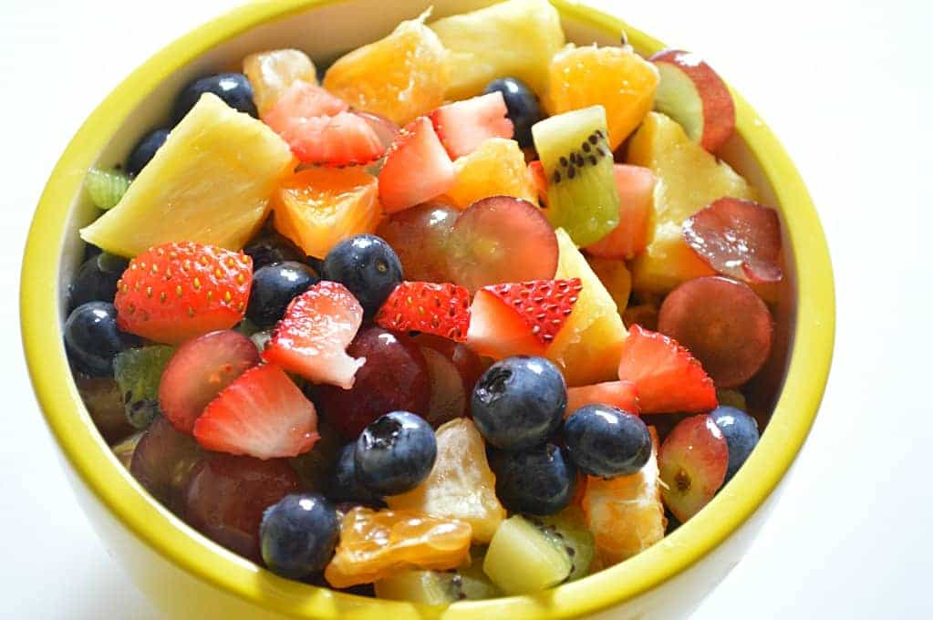 Rainbow Fruit Salad. The perfect snack to send in your kids lunchboxes! #poweryourlunchbox
