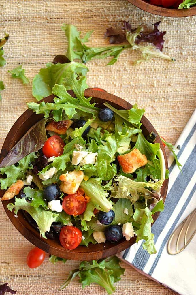 A fresh mix of lettuce, grilled chicken, blueberries, tomato, avocado, and feta topped with a citrusy Orange Vinaigrette.