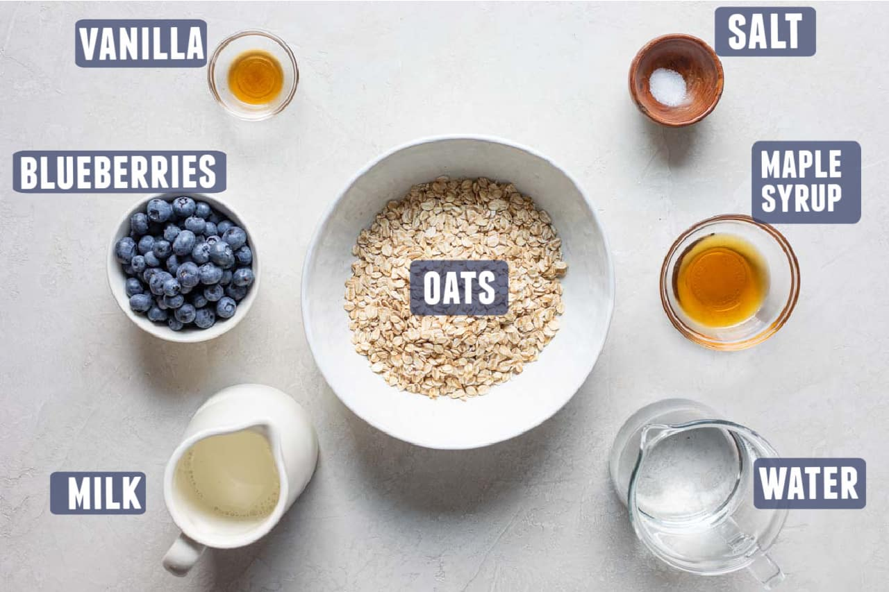 Ingredients needed to make Blueberry Oatmeal laid out on the counter.