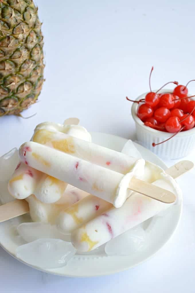 Cool down with these Pineapple Upside Down Pops made with Greek Yogurt and real fruit!