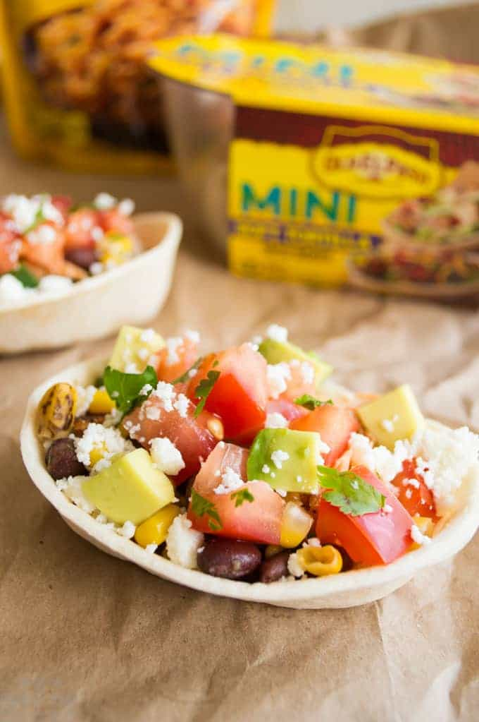 Blackened Salmon topped with grilled corn and black bean relish, and queso fresco, all in a little taco cup. Perfect weeknight dinner!