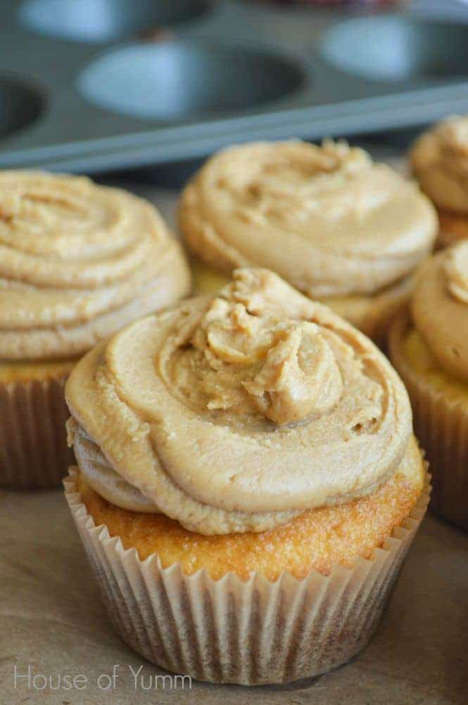 Cupcakes with peanut butter frosting filled with peanut butter and jelly