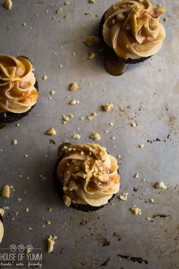 Snickers Brownie Bites. Dark Chocolate brownie bites topped with a fluffy peanut butter frosting, caramel and peanuts.