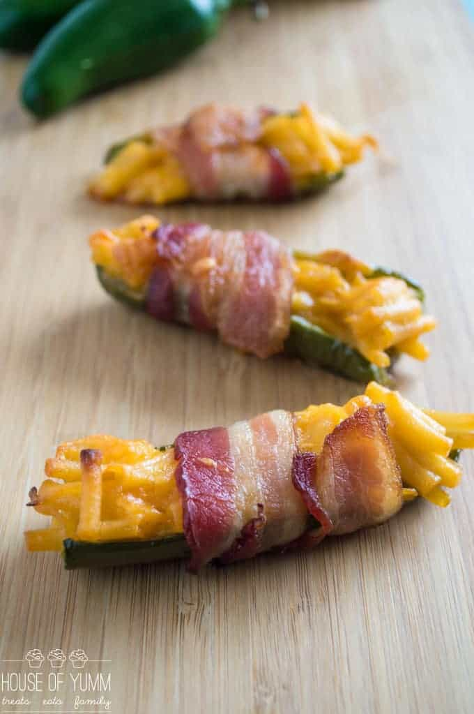 Mac & Cheese Stuffed Jalapenos wrapped in bacon make the ULTIMATE gameday appetizer!