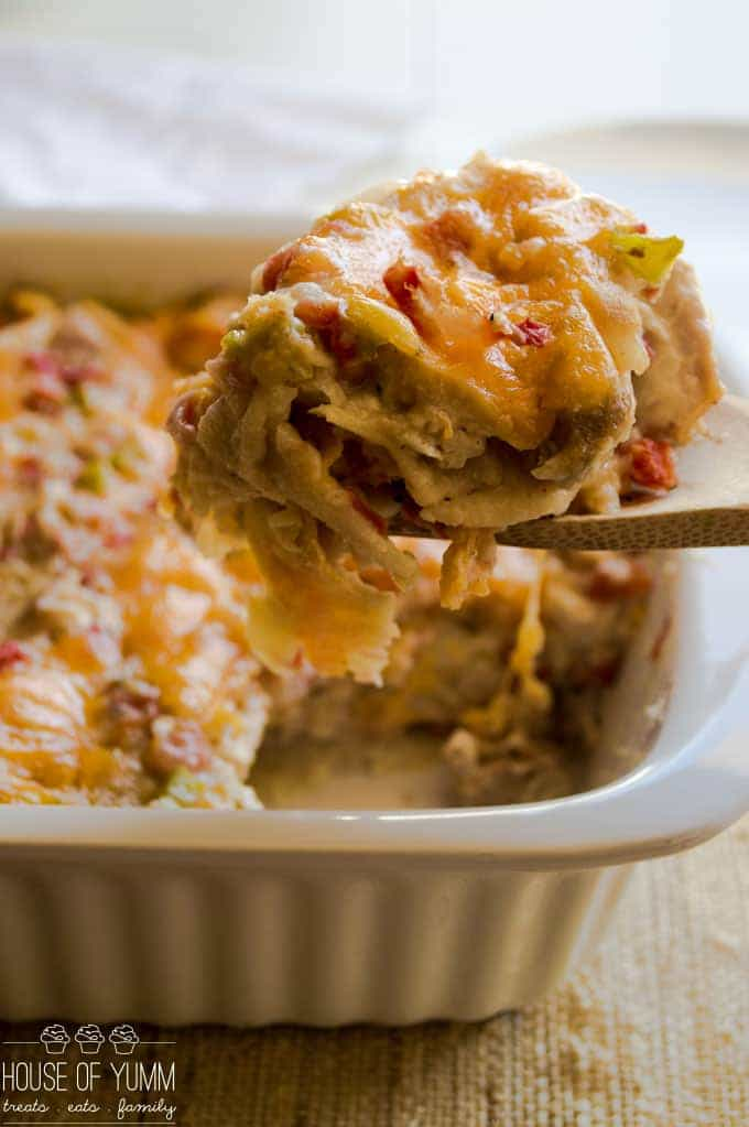 This lighter version of a classic is sure to please everyone who gathers around your family table! This creamy, cheesy, King Ranch Chicken Casserole is bursting with chunks of chicken, tomatoes, green chiles, and bell peppers.