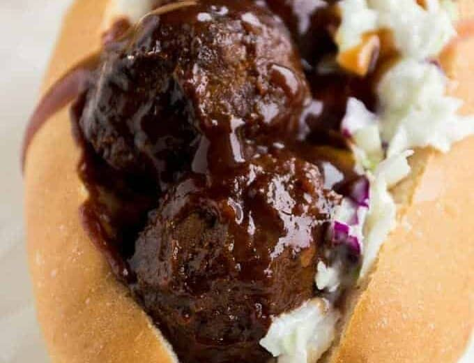 This meatball sub got a southern makeover with sweet and tangy BBQ sauce and a creamy cole slaw! Perfect family dinner recipe! Plus can be made in the slow cooker!