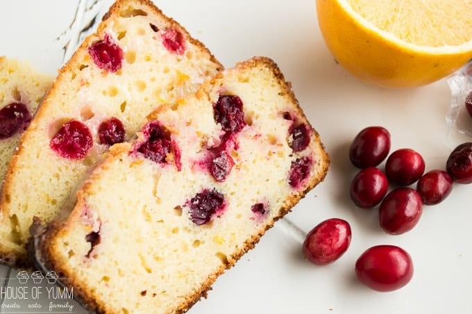 Super moist Cranberry Orange Bread drizzled with an orange zest glaze, bursting with tart cranberries. Made using fresh orange juice and greek yogurt! This bread is always a hit!!