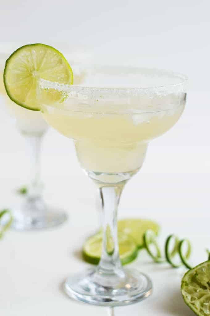 Celebrate in style with this Champagne Margarita. A bubbly combination of a lime margarita and champagne plus lime sugar on the rim of the glasses!