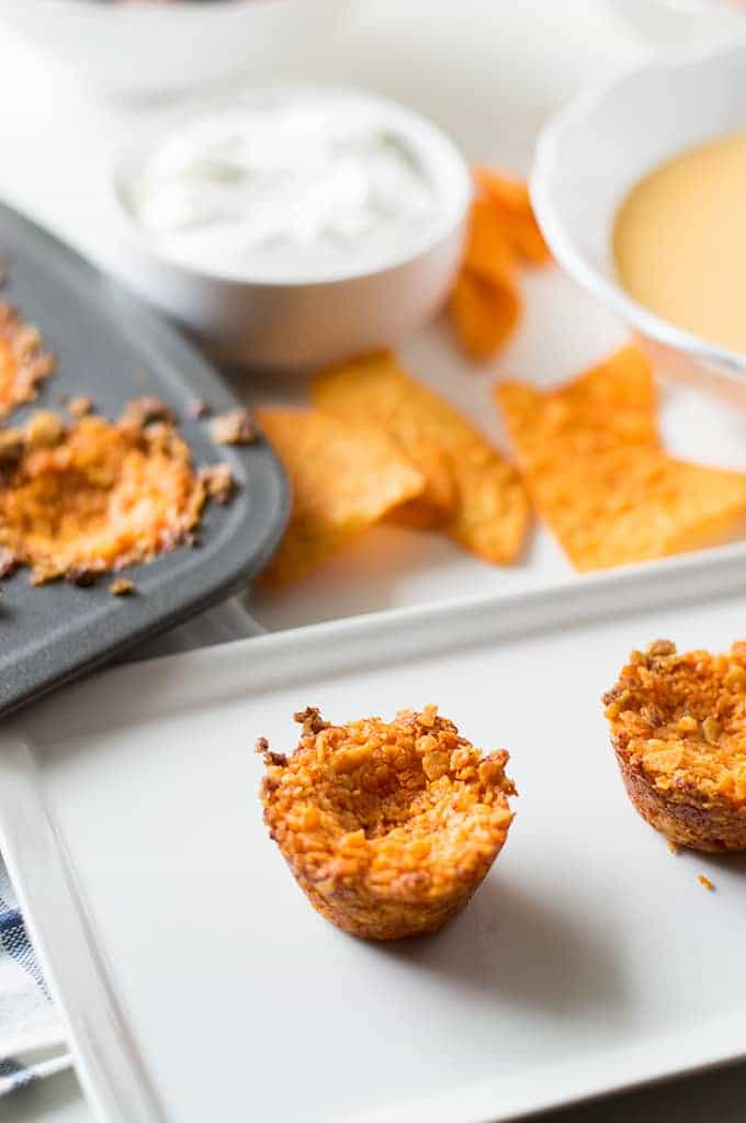 Nacho Cheese Chip Cups!! Made with actual crushed up nacho tortilla chips, loaded up with all your favorite toppings!! Perfect bite sized snack!