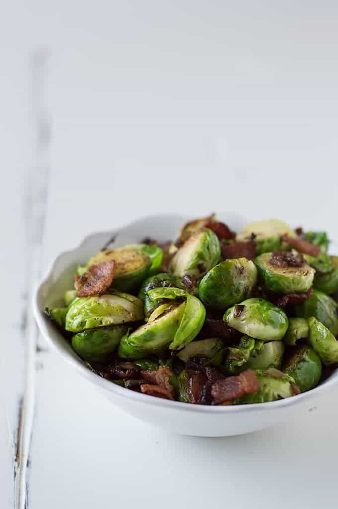 Brussel Sprouts with bacon and the best caramelized onions you've EVER had! Everyone will be begging to eat their veggies when this dish is involved!