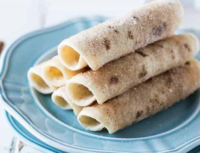 Blue plate with a stack of cinnamon tortilla rollups.