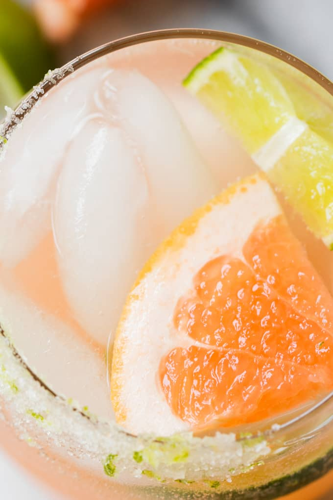 Overhead view of a Paloma on the rocks topped with a wedge of grapefruit.