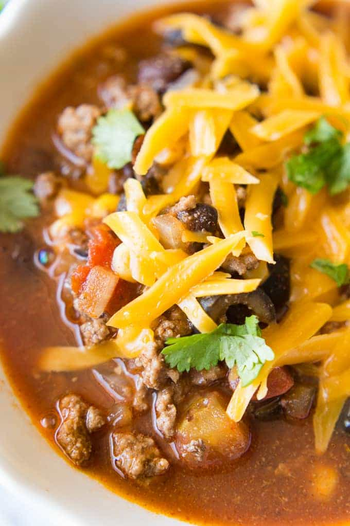 Get cozy with this delicious Taco Soup that you can make in under 30 minutes! It's the perfect quick and easy dinner!