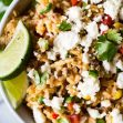 Tex Mex Rice! This EASY to make brown rice recipe is loaded with bits of juicy beef, spicy peppers, corn, onion, and more! This is the perfect side dish recipe!