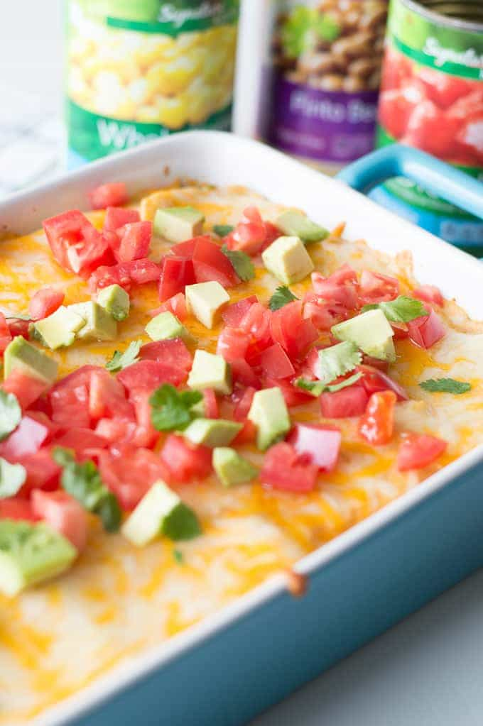 Easy, cheesy Texas Lasagna! This casserole dish is LOADED with southwest flavors. Layers of corn tortillas, flavorful meat sauce, plus a chile pepper cheese layer will have your mouth watering! Perfect dish for company or family dinner!