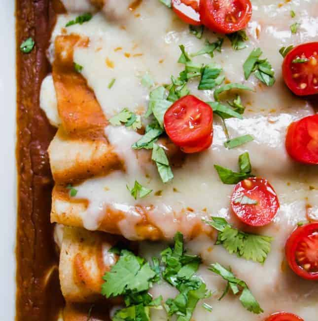 Cheese enchiladas baked with homemade enchilada sauce, topped with melted cheese.