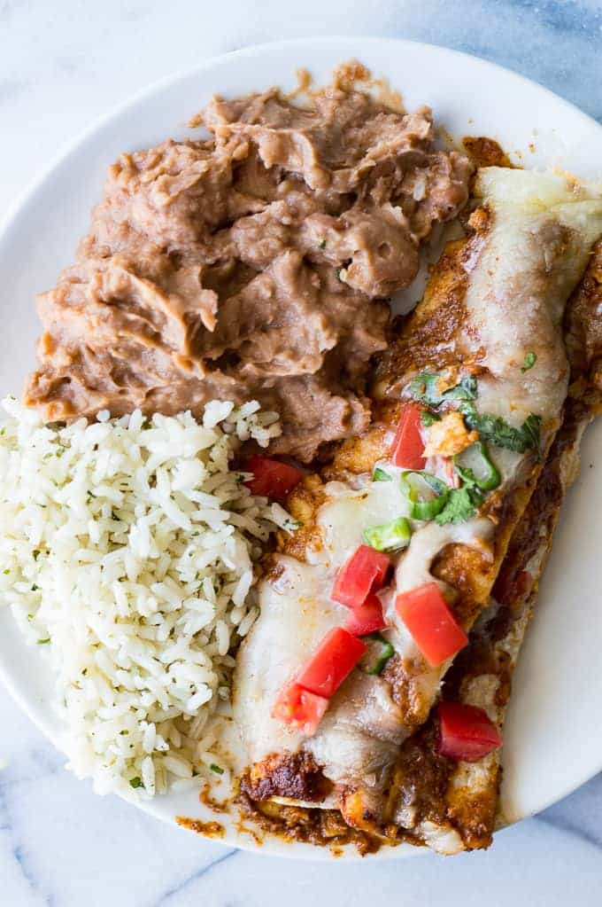 Classic Tex Mex Cheese Enchiladas made with Texas Chili Gravy, a homemade enchilada sauce recipe that is bursting with BOLD flavors. This easy meal can be put together in under 30 minutes making it perfect for a weeknight dinner!