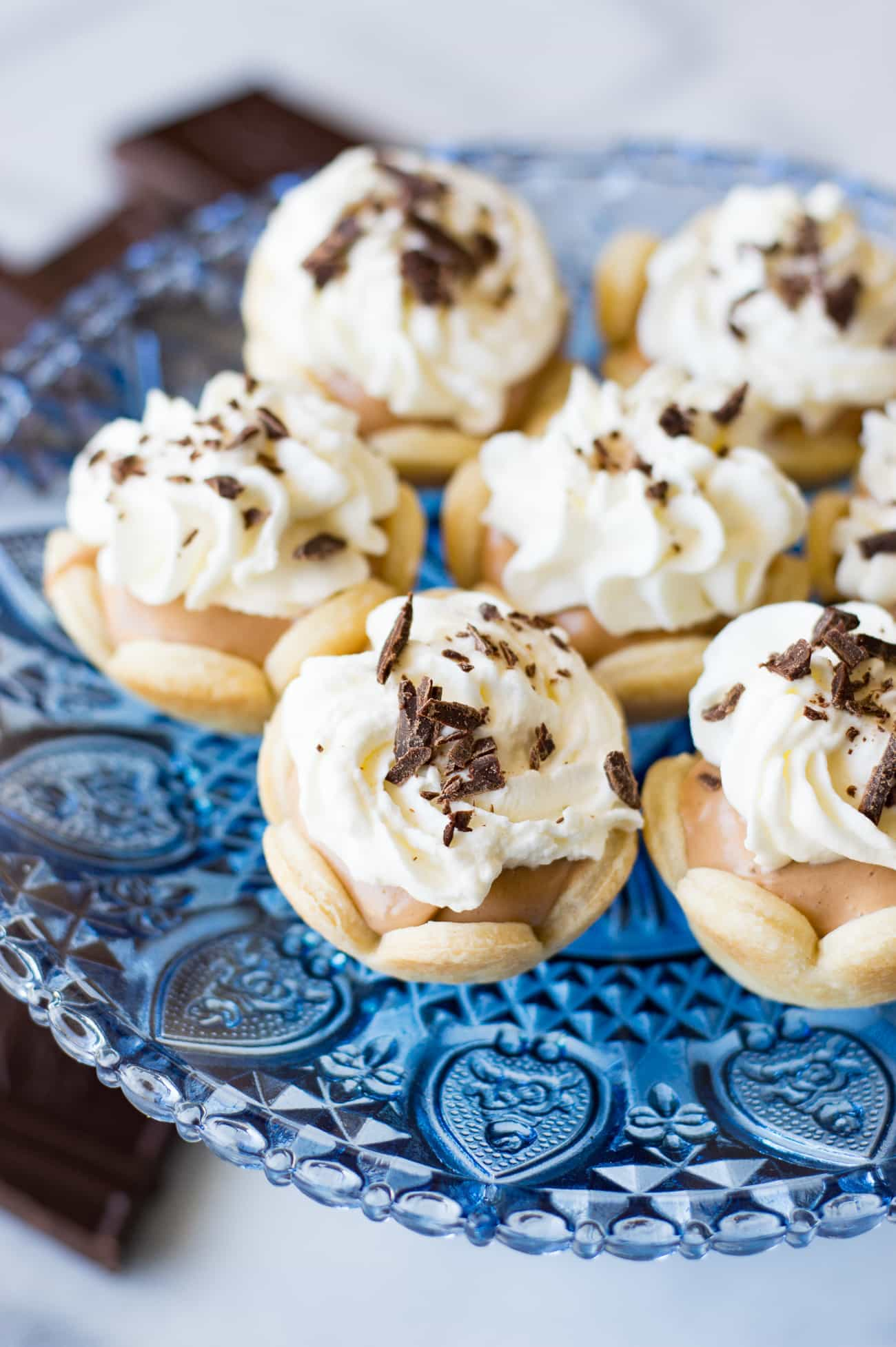 Mini French Silk Pies. Easy to make than you probably think and decadently DELICIOUS! Silky, creamy, chocolate bliss topped with homemade whipped cream. All in bite size mini pies!