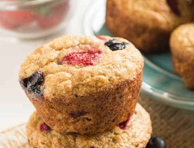 These healthy, EASY Mixed Berry Whole Wheat Muffins are the perfect breakfast recipe! Soft, tender muffins made with whole wheat flour, no refined sugars and loaded with fresh berries!