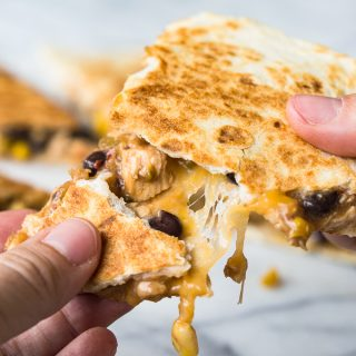 This Cowboy Quesadilla is loaded up with a BBQ Chicken, a black bean Texas caviar and lots of fresh off the block, melty cheese! Perfect for dinner time, this dish will please the whole family!