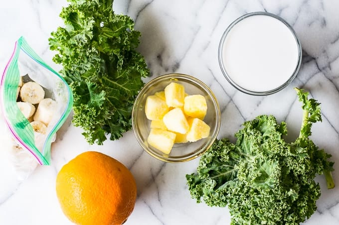 A refreshingly, simple, easily customizable Green Smoothie! Made with kale, orange, pineapple, and coconut milk. Plus it tastes good!!