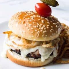 Crispy Fried Onion Swiss Burgers! A creamy swiss cheese sauce and crispy fried onion strings are the perfect complement for any juicy burger this grilling season!