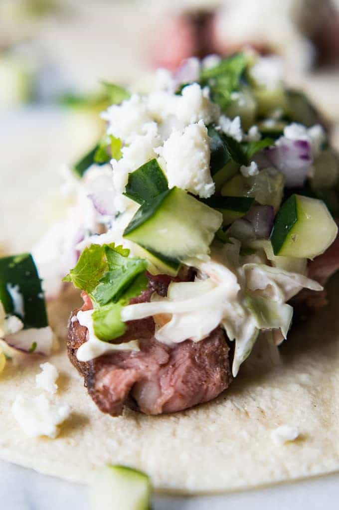 Spicy Habanero Grilled Lamb liven up these tacos, that are a perfect blend of Mexican and Mediterranean flavors! Cool and creamy mojito cole slaw, cucumber salsa, and queso fresco complete the dish! Perfect recipe for grilling season!