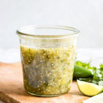 Jar filled with homemade salsa verde.