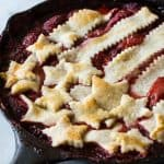 This strawberry cobbler is juicy and sweet! Plus it's topped with a patriotic display of pie crust. Perfect for celebrating the 4th of July!