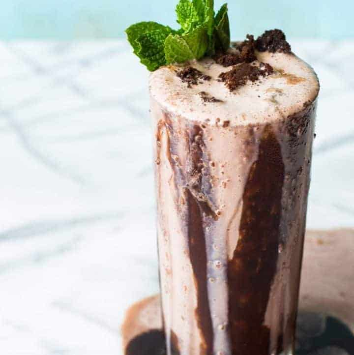 This creamy Thin Mint Brownie Milkshake is loaded with the chocolate and a cool hint of mint to remind you of your favorite Girl Scout Cookies!
