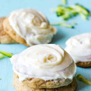 These soft zucchini cookies taste like zucchini bread and are topped with a thick cream cheese frosting!