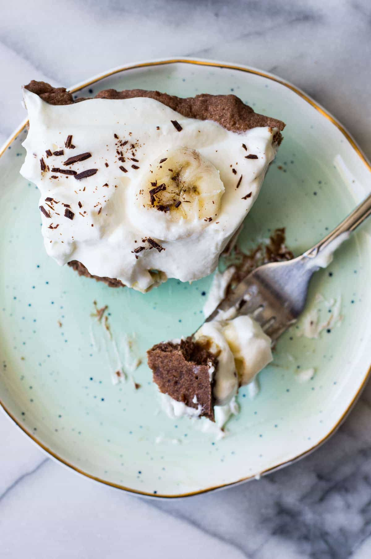 Chocolate Banana Cream Pie. Chocolate pie crust loaded up with layers of chocolate cream, bananas, and vanilla cream. All topped with a thick layer of whipped cream!