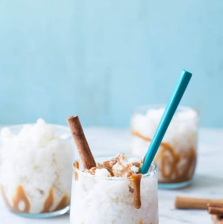 Homemade horchata frozen into a granita and drizzled with dulce de leche! A perfect cold treat bursting with cinnamon and caramel flavors!