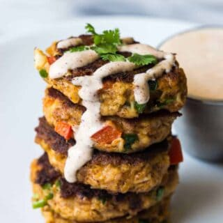 Tex Mex Crab Cakes are bursting with flavor and spice. Packed with fresh peppers, cilantro and lime juice, these crab cakes will definitely be the highlight of any meal!