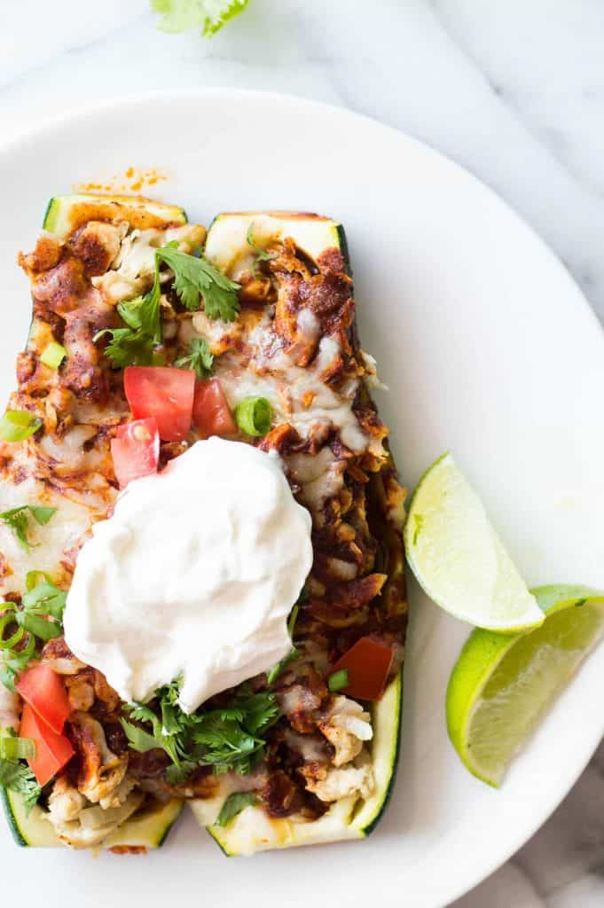 Easy to make Zucchini Boat Chicken Enchiladas! A tasty way to eat more veggies that the whole family will love!