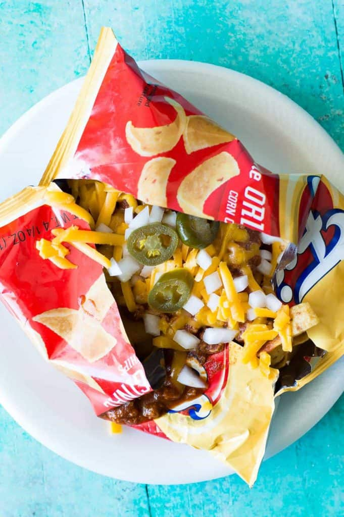 Frito pie made in the chip bag. Made using 20 minute texas chili, cheese, onion, and jalapeño.