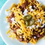 20 Minute Texas Style Chili! This Texas style chili is bursting with meat and spice, and only takes 20 minutes to come together. And this is the ideal chili to have on a Frito Pie!! Perfect for gamedays or family dinner!
