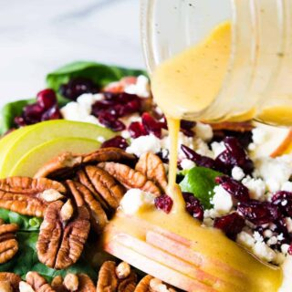 Autumn Apple Salad with a Maple Vinaigrette will let you celebrate all the flavors of Fall! Pecans, cranberries, apples, feta and baby spinach all drizzled with an easy to make maple dijon vinaigrette!